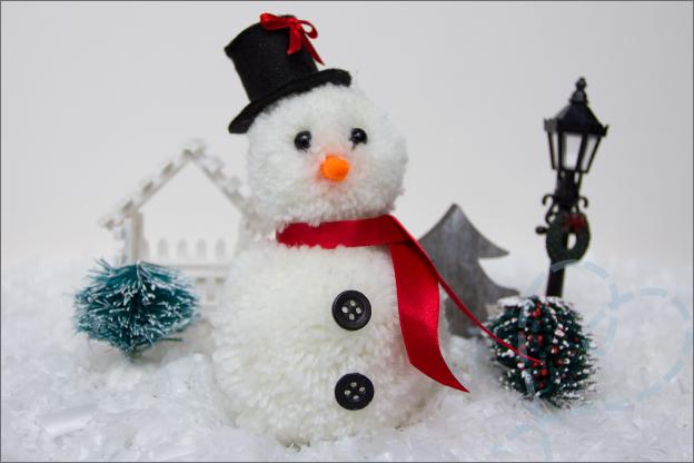 sneeuwpop van pompons