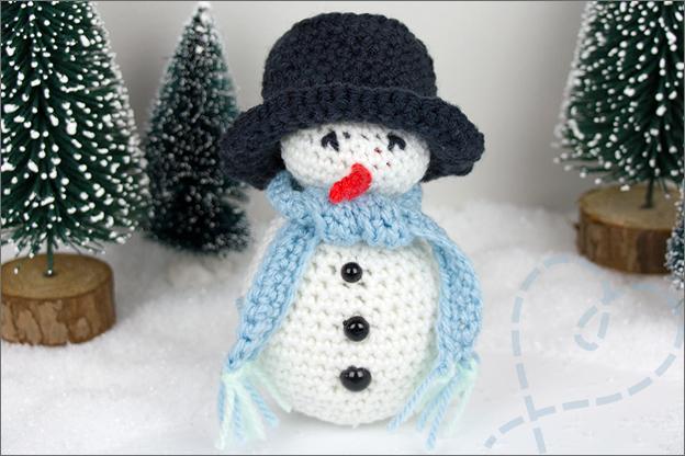 Haken patroon sneeuwpop dichtbij