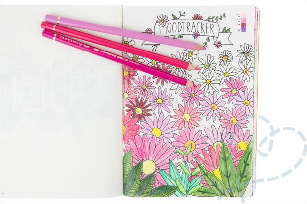 Bullet journal mood tracker ingevuld kleuren bloemen