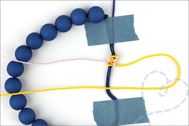 Hoe maak je een verschuifbare knoop