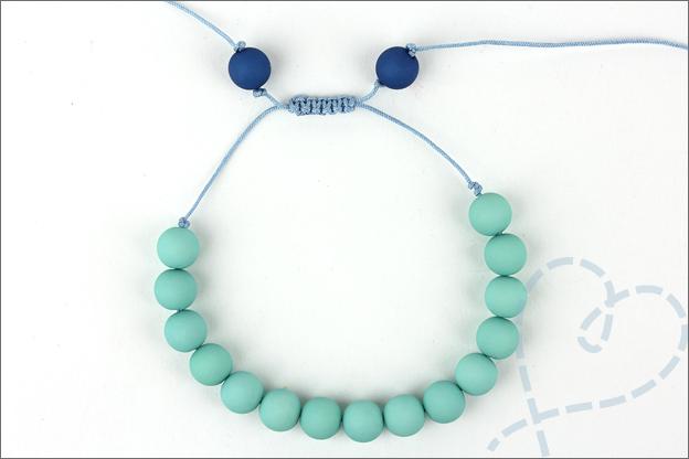 uitleg armband verschuifbare knoop Kralen