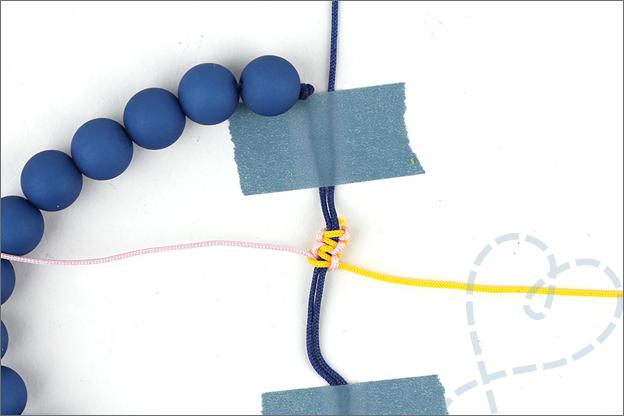 uitleg armband verschuifbare knoop aantrekken