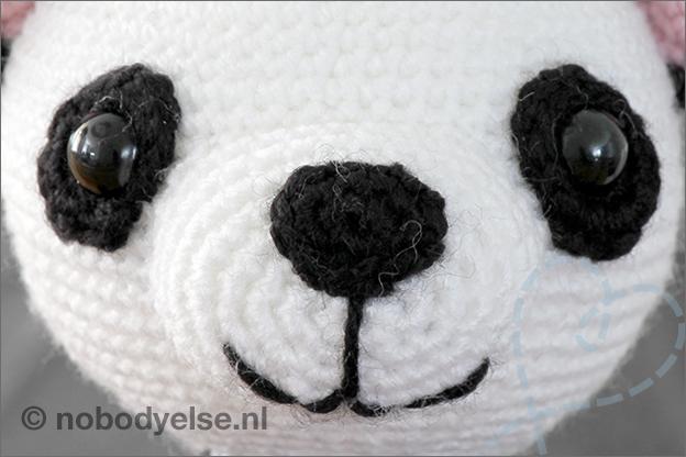 Haken panda ogen snuit