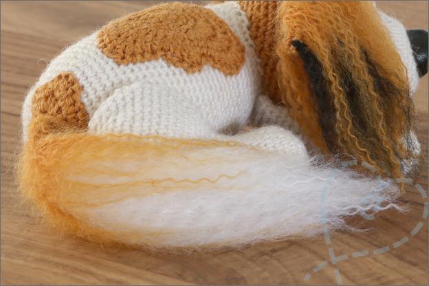 Haken hondje sokkewol kooiker staart